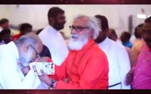 Admirer kissing the hand of K.P. Yohannan. From his 2017 birthday video.